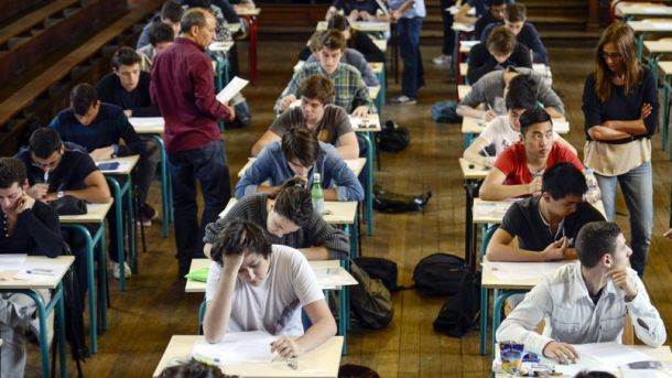 French students work on the test of philosophy as they take the baccalaureat exam (high school graduation exam) on June 16, 2014 at the Jacques Decour high school in Paris.  AFP PHOTO / FRED DUFOUR