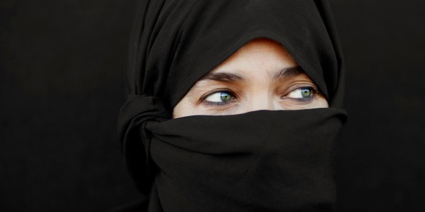 Mature woman in hijab looking to side, close-up